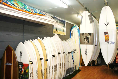 Shop owner Kelly Richards also shapes custom surfboards under his Perfection Surfboards label, so you can be sure that Village Surf Shoppe has your hard goods needs covered. Photo: Courtesy Village Surf Shoppe
