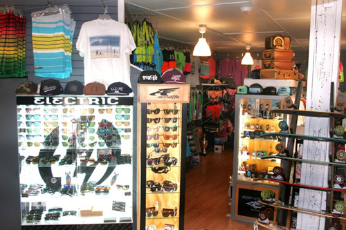 There are tons of accessories and guys clothing items to choose from, like that custom Village Surf Shoppe photo T-shirt above the sunglass case. Photo: Courtesy Village Surf Shoppe