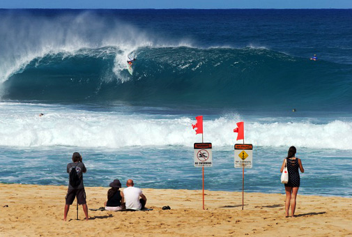 Does this photo look familiar? It's the same one on the T-shirt of local teamrider Cam Richards, Kelly's son, charging at Pipeline. Photo: Brian Bielmann