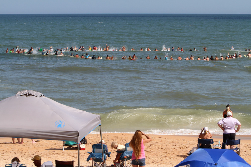 Tommy Tant memorial paddle-out. Photo: Dugan