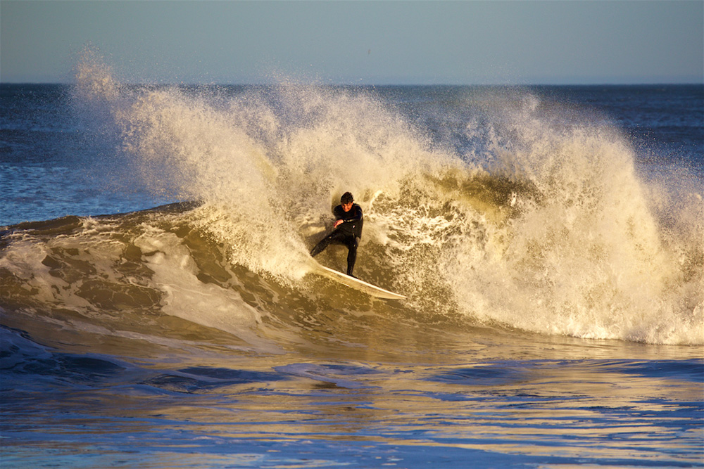 """""""It's been a pretty fun run of swell,"""" said Outer Banks photographer Jon Carter. """"Sunday the waves really turned on right before dark and it was really warm, hitting 70 degrees. On Monday, it was still fun but it only hit 40 degrees. Crazy weather! Which didn't slow Max Lingg down one bit."""" Photo: Jon Carter"""