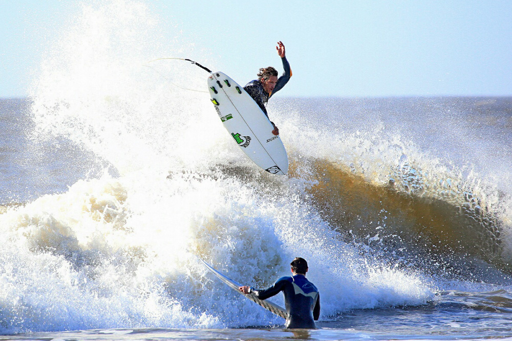 Think Kyle Busey was jealous of all the barrels scored by surfers north and south of his Folly Beach, SC, home? Maybe — but blasting an air like this is one way to forget about all that noise. Photo: Matt Drobnik