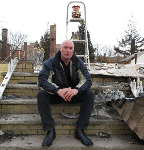 "3 / 4 Michael McDonnell, pictured here on the steps of his destroyed Belle Harbor home, was setting up a rope bridge to save neighbors from Hurricane Sandy's storm surge when Dylan Smith paddled up to help. ""He was a guardian angel in a wetsuit,"" McDonnell said in an article written for the New York Daily News. ""His calmness and ability to work with me like a team stood out immediately. It was at that moment I knew I had a great person at my side."" Photo: New York Daily News"