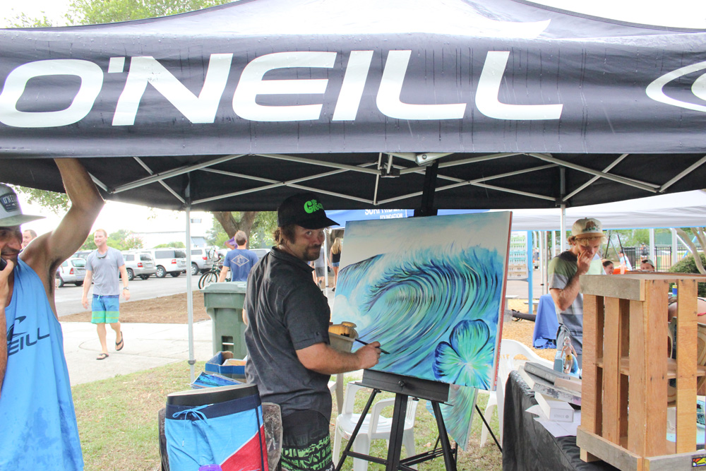 The Music and Art Fest that runs alongside the surf contest is as much of an avenue for local artists like Chris Mickey, Carleigh Sion, and Colin Peterson to showcase art as it is a fundraiser for organizations like Hope For Helen and the UNCW Surf Club to help raise money for their organizations. Photo: Beaufort