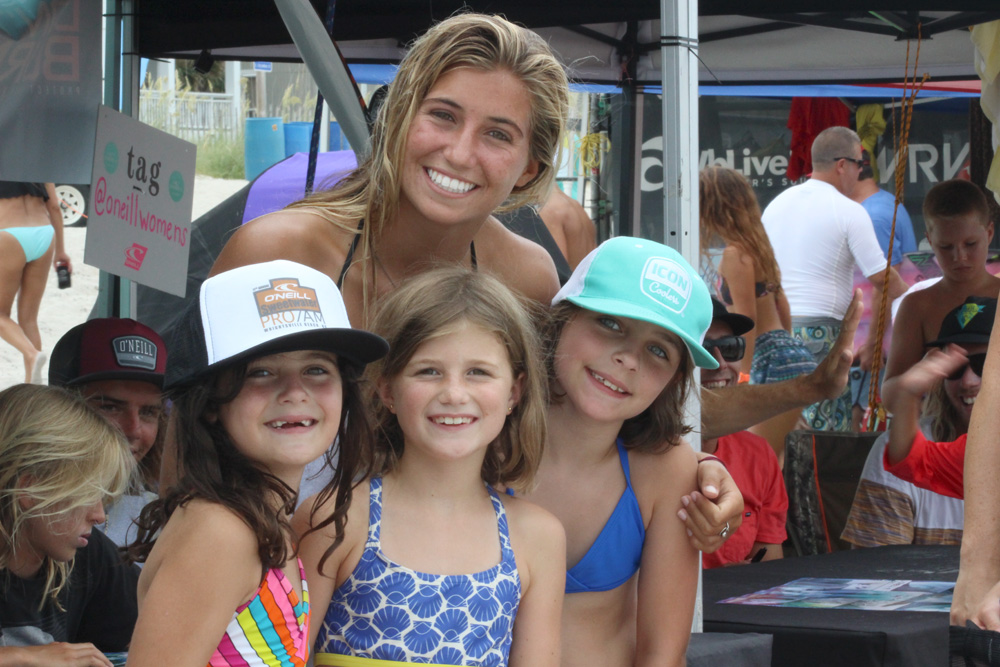 3rd-place Girls Open Shortboard finisher Molly Kirk with a few of her young fans and their custom O'Neill/Sweetwater hats printed right at the contest. Photo: Beaufort