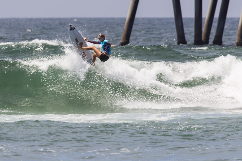 Stephanie Gilmore surfing during Heat Four of Round 3 at The Vans US Open of Surfing