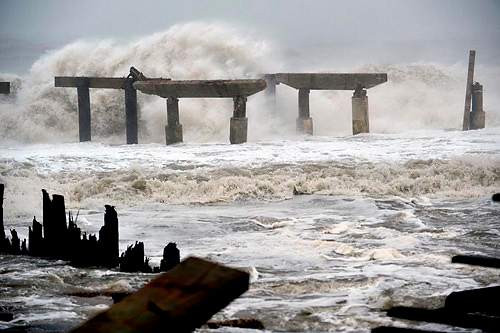 The eye of Hurricane Sandy came ashore near Atlantic City, NJ, on Monday with winds in excess of 85 mph, seas of 30 to 40 feet, and a massive storm surge that laid waste to many of the area's piers, boardwalks, oceanfront structures, and homes. Photo: Stan Honda/AFP/Getty Images