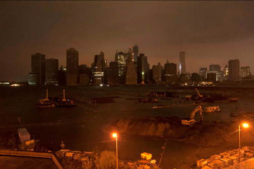 Widespread power outages Monday night in New York City left Manhattan's usually sparkling skyline almost entirely dark, one of the eeriest images we've ever seen. At last estimate, over a million people were still without power. Photo: Keith Bedford/Reuters