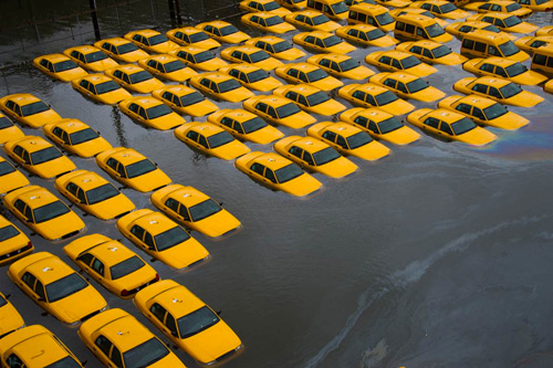Taxi cabs in Hoboken, NJ, sit in several feet of water. Transportation options across the region were severely constrained, with subway and train systems offline, airports just reopening, and only a few bridges and tunnels into New York City open. Photo: Charles Sykes/Associated Press