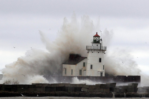 Even the Great Lakes bore the brunt of Hurricane Sandy, with massive seas rocking this lighthouse near Cleveland, OH. Don't be surprised if later this week some of the most jaw-dropping surf shots come from our friends on the freshwater Third Coast. Photo: Tony Dejak/Associated Press