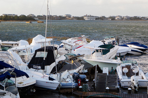 While most news reports focused on the damage in New Jersey and New York City, Long Island endured massive flooding of its own. Here's a couple hundred thousand dollars worth of boats turned to rubbish in East Quogue, NY. Photo: Lucas Jackson/Reuters