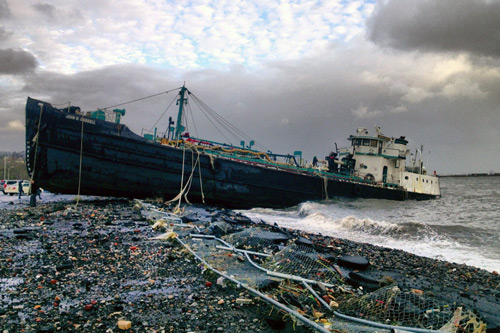 The John B. Caddell, a 168-foot water tanker, washed ashore on Front Street in the Stapleton neighborhood of Staten Island on Monday. Photo: Sean Sweeney/Associated Press