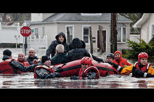 First responders from the New York Police Department and other governmental agencies have been working for several days straight, with many more nonstop shifts still to come. Here, a crew rescues a family stranded by flooding on Staten Island. If you see any police, fire, or paramedics over the next few days, tell 'em thanks for their hard work and constant sacrifices. Photo: Michael Kirby Smith/The New York Times