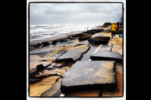 Although Hurricane Sandy didn't directly impact North Carolina, several Outer Banks highways like this one in Kitty Hawk were destroyed by relentless winds and ocean overwash, with soundside flooding also devastating the area. Photo: Laurin Walker