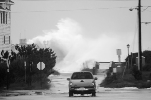 """North Carolina photographer Ben Gallop sent this photo of Jennette's Pier in Nags Head getting smashed: """"The deck of the pier is 25' above mean seal level and the top of the building on the end of the pier is about 17' higher, according to John Cheshire, who helped manage the pier's construction."""" Reports do indicate that the newly refurbished pier did escape any major damage. Photo: Ben Gallop"""