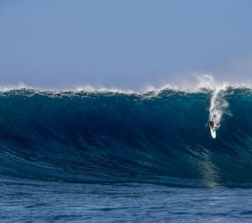 Riding big waves in Maui.
