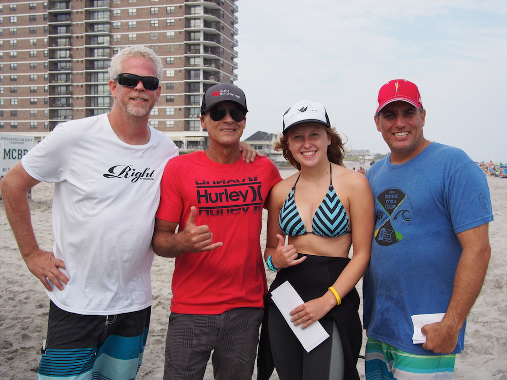 Maddie Allen, 17, of Downingtown, Pennsylvania is congratulated for her Surf It Forward fundraising efforts at the 16th annual Surf for a Cause. She is awarded a custom-shaped surfboard by Brian Wynn by, from left, Dean Randazzo Cancer Foundation President Mark Zappone of Linwood, Dean Randazzo of Atlantic City and event coordinator Dan Cellucci of Linwood.