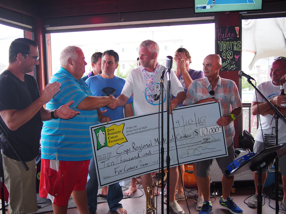 Mark Zappone presenting $10,000 to Cape Regional Health System at the 16th Annual DRCF Surf For A Cause
