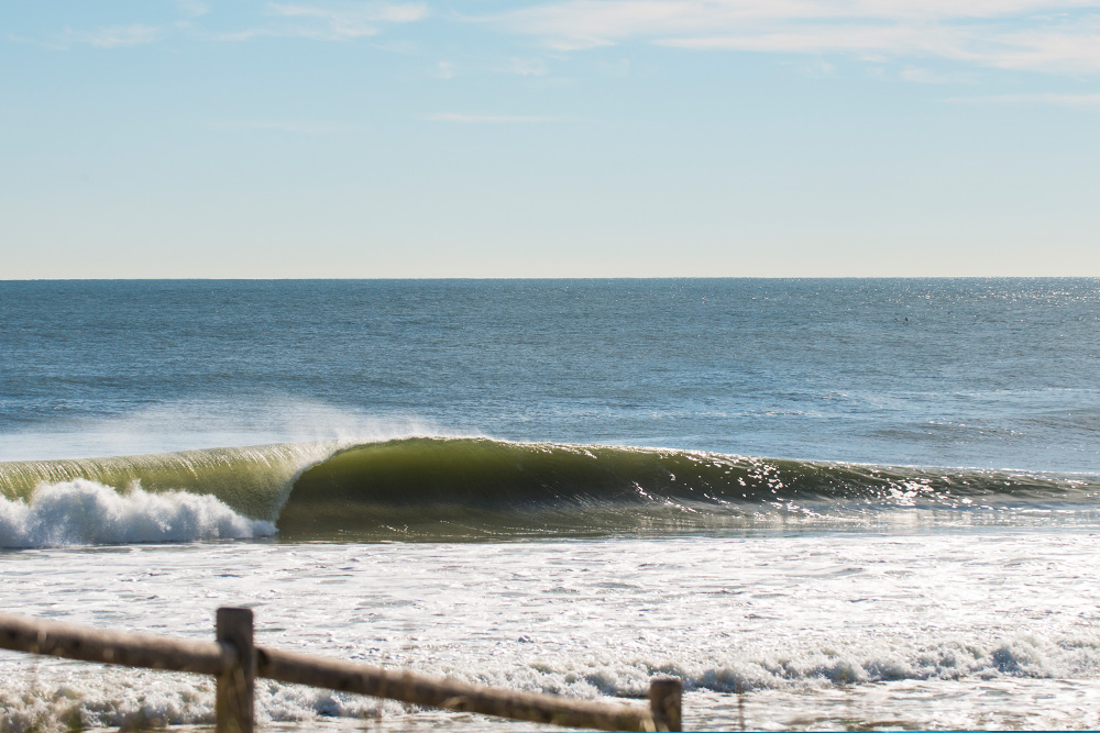"""A couple breaks were super crowded with people from all over New Jersey,"" photographer Dan Pryzgocki says. ""But my friends and I cruised five minutes down the island until there was no one around — like when this wave came through."" Photo: Dan Pryzgocki"