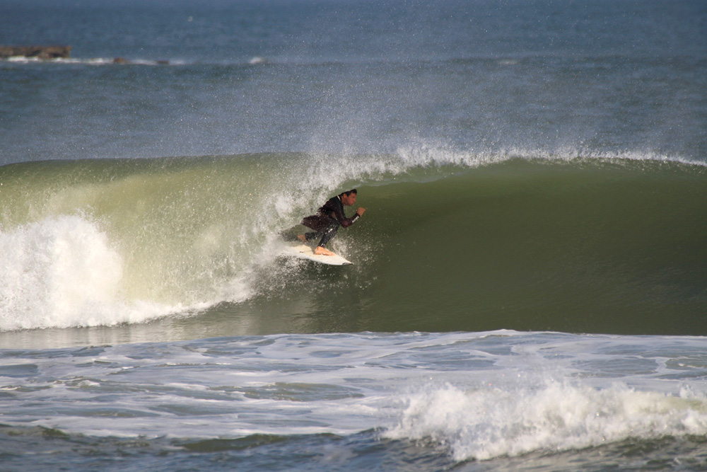 """""""With arctic temperatures biting through snow jackets, hats, boots, and wool socks, who could possibly imagine choosing to plunge into a dark and frigid ocean over seeking out warmth and comfort?"""" Jeremy Johnston, fully immersed in New Smyrna Beach. Photo: Marty Ficalora"""