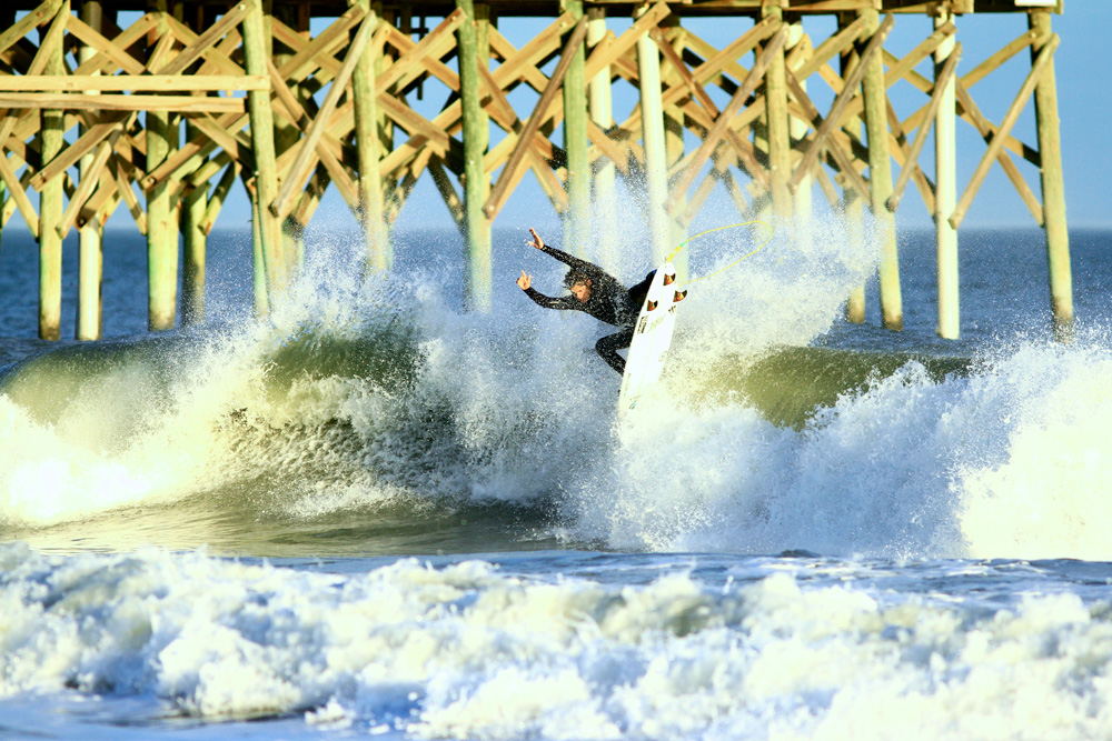 """""""By the time you make it back to shore, you're hooked. Now you're one of them: the crazy ones. The cult of cold-water surfers."""" South Carolina's Cam Richards wears his membership with pride. Photo: Meghan Whitney"""
