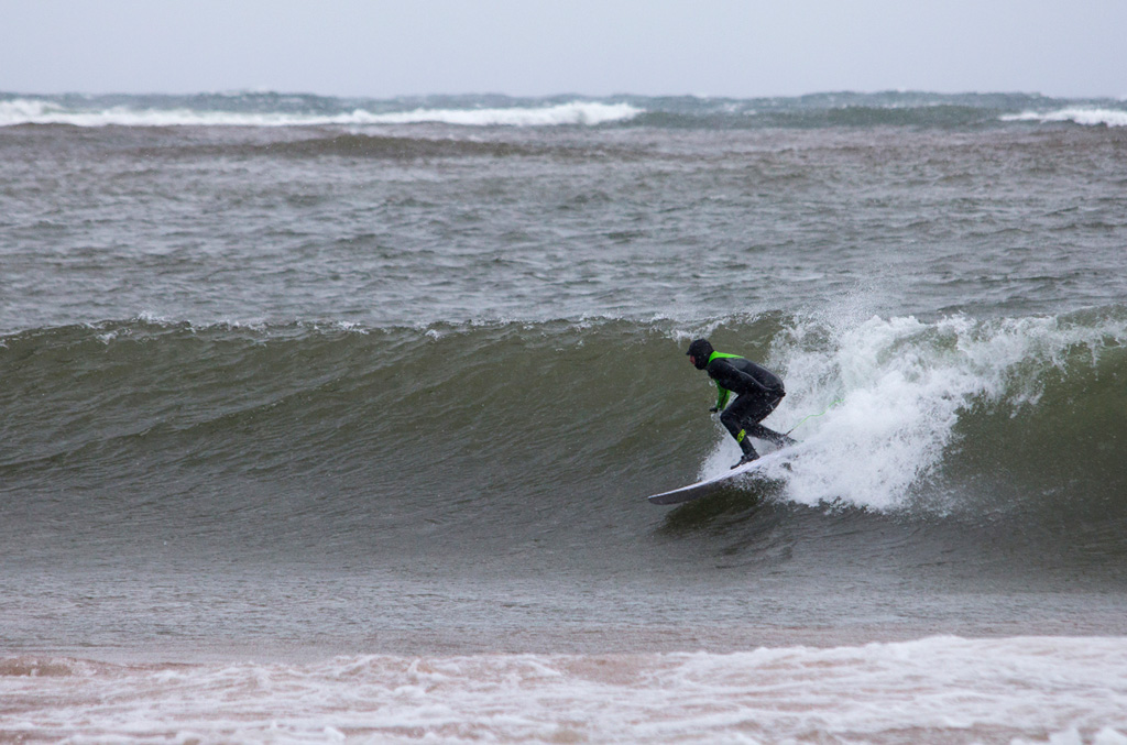 Wil Wall tames the wintry Lake Superior beast. Photo: Brian Tanis