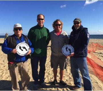 Richard Lee of Surfers Environmental Alliance, Chris Robinson, Larry Schmidt, and Bob Duerr of the Manasquan Boardriders Club. Photo: James Contreras